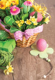 Easter basket on wooden table with handmade decorations, text sp Royalty Free Stock Image