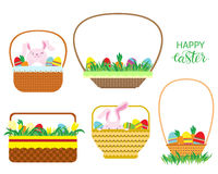 Easter baskets with Easter eggs, carrots and bunnies isolated on white background. Royalty Free Stock Photography