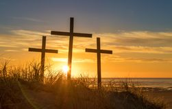 Easter Beach. Three cross on a sand hill as the sunsets Royalty Free Stock Photo