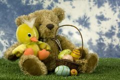Easter bear and duck with basket of eggs Royalty Free Stock Photography