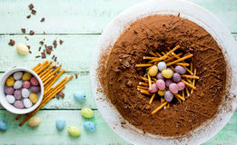Easter bird nest cake - chocolate cake with pastel candy eggs in Royalty Free Stock Photo