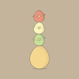 Easter birds eggs. An image of three little birds balancing on a colored Easter egg isolated on a plain background Royalty Free Stock Photography
