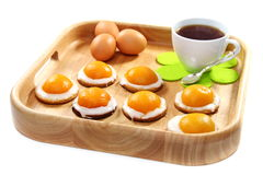 Easter biscuits and a cup of tea on wooden tray. Stock Images