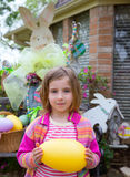 Easter blond girl holding big egg and bunny Stock Photography