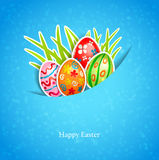 Easter blue background with egg and grass Royalty Free Stock Photo