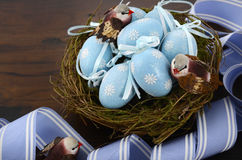 Easter blue decoration eggs in birds nest Stock Images