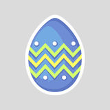 Easter blue egg isolated on a gray background  with a colored contrasting ornament of zig zag and dots. Easter blue egg isolated on a gray background Royalty Free Stock Photos