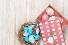 Easter with blue and white eggs in nest and gift box Stock Images