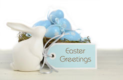 Easter Blue and White Theme Table With Bunny. Happy Easter blue and white theme eggs on white wood table background Royalty Free Stock Photo