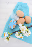 Easter Blue and White Theme Table with Fresh Eggs Royalty Free Stock Images