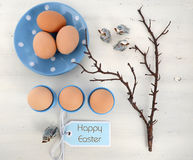 Easter Blue and White Theme Table. Happy Easter blue and white theme eggs on white wood table background Stock Image
