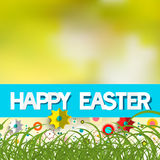 Easter Blurred Bokeh Background with Grass. Colorful Paper Cut Flowers and Title Happy Easter Stock Photos