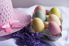 Easter bonnet with colored eggs and purple grass Stock Image