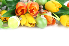 Easter border. Border made of green Easter eggs and colorful tulips isolated on white background stock image