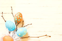 Easter border. With eggs and twigs on whte linen textile, close up, horizontal, copy spase, retro filter royalty free stock photo