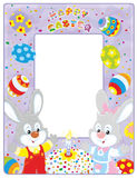 Easter border with bunnies. Frame border with Easter Bunnies, a fancy cake and colorfully painted eggs Stock Photos