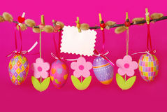 Easter border with hanging eggs Royalty Free Stock Photography