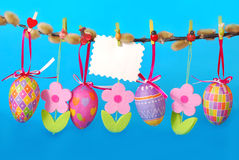 Easter border with hanging eggs Royalty Free Stock Photo