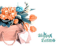 Easter border with orange flowers and spring decorations on whi Stock Photography