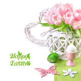 Easter border with pink tulips and matching spring decorations. Isolated on white, space for your text Stock Photo