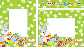 Easter borders. Frames with Bunny coloring Easter eggs on a green lawn with daisies Stock Image