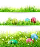 Easter borders. Set of three Easter borders with colorful eggs in grass Royalty Free Stock Photos