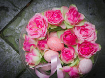 Easter bouquet of pink eggs and pink roses. Stock Photos