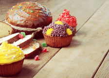 Easter bread and  cakes on the wooden table Stock Image