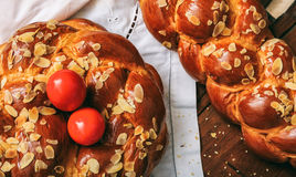 Easter bread and eggs on a table - top view. Easter traditional bread and red eggs on a table -  top view Stock Photos