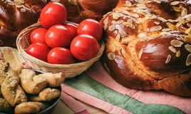 Easter bread and eggs on a table. Easter traditional bread and red eggs on a table Royalty Free Stock Photos
