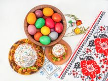 Easter holiday. Easter bread and eggs on a white tablecloth with patterns stock image