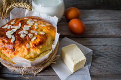 Easter bread and ingredients on rustic wood background stock photography