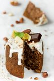 Easter bread panettone kulich paska stuffed with cottage cheese,. Coconut, nut and chocolate filling Royalty Free Stock Image