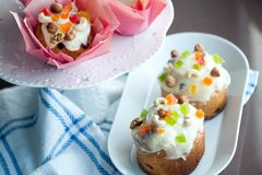 Easter bread with white icing, candied fruits and nuts Royalty Free Stock Photography