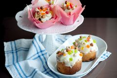 Easter bread with white icing, candied fruits and nuts Stock Photo