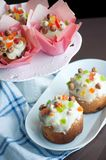Easter bread with white icing, candied fruits and nuts Stock Photos