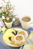 Easter Breakfast. An Easter breakfast with ham and cheese English muffins, fresh pineapple and blueberries, with Easter decorations and fresh hot coffee Royalty Free Stock Photo