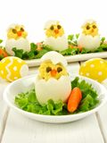 Easter breakfast of chick eggs Stock Photos