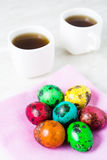 Easter breakfast with color quail eggs two cup of tea Royalty Free Stock Images