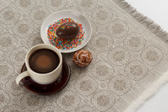 Easter breakfast concept. Cup of coffee with hand drawn egg and chocolate egg Royalty Free Stock Photography