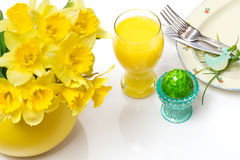 Easter breakfast, easter egg, daffodils, orange juice Royalty Free Stock Photography
