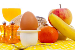 Easter breakfast with egg, bread, fruits and drinks Stock Photography