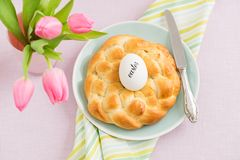 Easter breakfast table. With Easter egg, tulips and sweet braided yeast bread royalty free stock photo