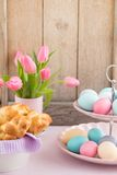 Easter breakfast table. With Easter eggs, tulips and sweet braided yeast bread stock photography