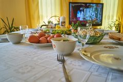 Easter breakfast table with foods and decorations stock image