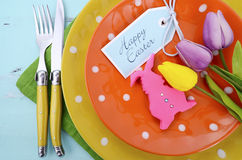 Easter bright color orange, yellow and green polka dot theme table place setting Stock Photo