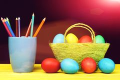Easter Bright Composition Holding Painted Easter Eggs And Coloured Crayons Stock Photos