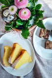 Easter brunch dessert with lemon cake slices and chocolate brown Stock Image