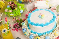 Easter brunch. Dessert table set with cake and cupcakes for Easter brunch Stock Photos