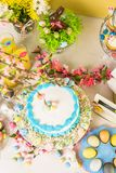 Easter brunch. Dessert table set with cake and cupcakes for Easter brunch Royalty Free Stock Photo